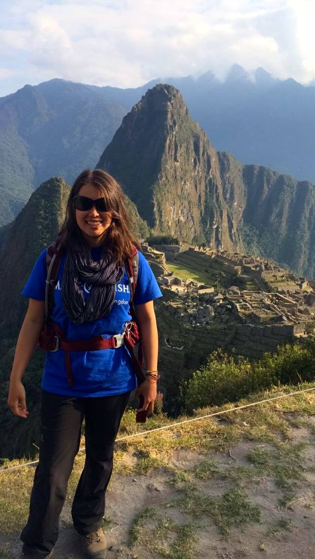 me in front of Machu Picchu wearing Make A Wish t-shirt
